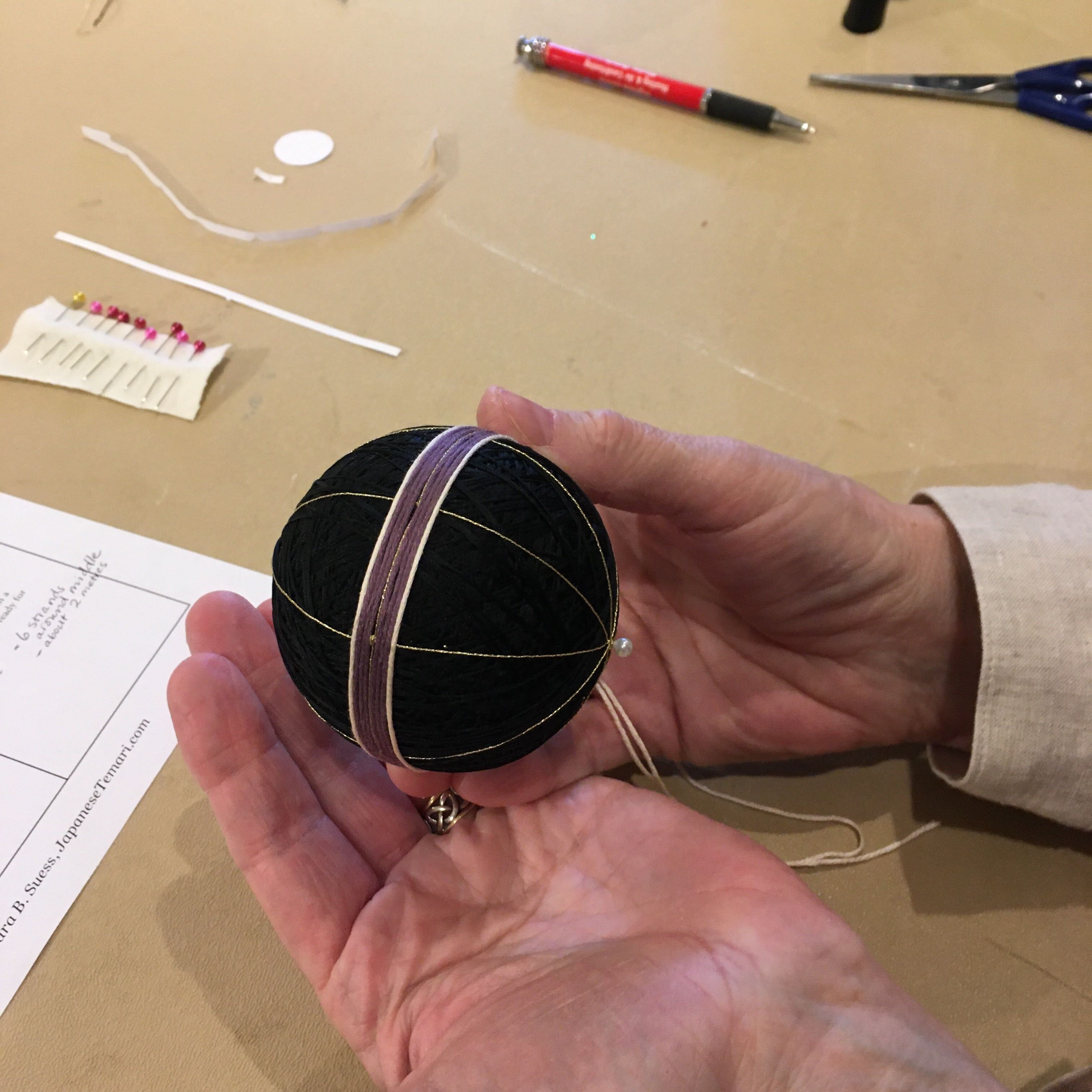 hand holding temari ball